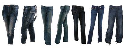 Colección de varios tipos de pantalones de los tejanos Foto de archivo libre de regalías