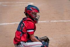 Colector adolescente del béisbol detrás de la meta Fotos de archivo