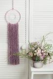 Colector ideal rosado con las flores Imagen de archivo