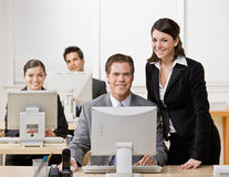 Colega de trabalho que escuta o supervisor Foto de Stock Royalty Free