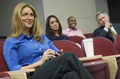 Colegas del negocio en un seminario Foto de archivo libre de regalías