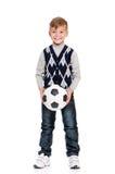 Colegial con el balón de fútbol Fotos de archivo libres de regalías