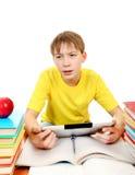 Colegial con el ordenador de la tableta Fotografía de archivo libre de regalías
