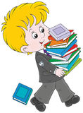 Colegial con los libros de texto Imagen de archivo libre de regalías