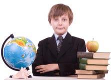 Colegial con los libros, el globo y la manzana Imágenes de archivo libres de regalías
