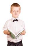Colegial en la camisa blanca con el libro aislado Foto de archivo libre de regalías