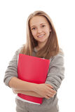 Colegiala adolescente sonriente en el fondo blanco Fotos de archivo