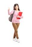 Colegiala adolescente que da un pulgar para arriba Imágenes de archivo libres de regalías