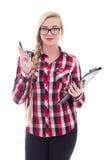 Colegiala atractiva en lentes con la carpeta en su aislador de la mano Fotografía de archivo libre de regalías