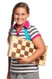 Colegiala con el tablero de ajedrez Imagen de archivo libre de regalías