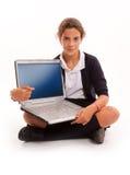 Colegiala con la computadora portátil Foto de archivo