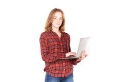 Colegiala con la computadora portátil Imágenes de archivo libres de regalías