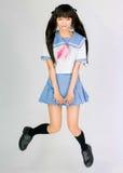 Colegiala cosplay de salto linda japonesa Fotos de archivo libres de regalías