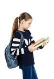 Colegiala de la muchacha con la mochila y los libros Imagen de archivo libre de regalías