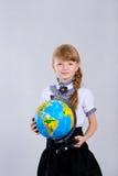 Colegiala hermosa linda con un globo Imagen de archivo libre de regalías