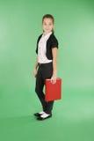 Colegiala joven con el libro rojo Imagen de archivo