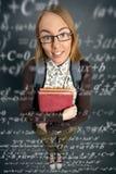 Colegiala linda con fórmulas Fotos de archivo libres de regalías