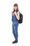 Colegiala linda con la mochila aislada en blanco Fotos de archivo libres de regalías