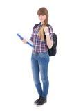 Colegiala linda con la mochila aislada en blanco Imagen de archivo
