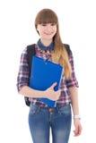 Colegiala linda con la mochila y carpeta aislada en blanco Imágenes de archivo libres de regalías