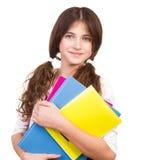 Colegiala linda con los libros coloridos Fotografía de archivo libre de regalías