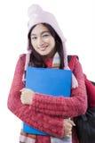 Colegiala linda con ropa del invierno Imagen de archivo libre de regalías