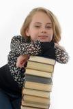 Colegiala sonriente con los libros Imagenes de archivo