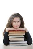 Colegiala sonriente con los libros de texto Fotografía de archivo libre de regalías