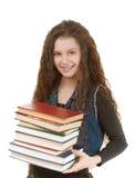 Colegiala sonriente con los libros de texto Fotografía de archivo