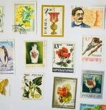 Coleção de selos velha no Livro Branco Fotos de Stock Royalty Free