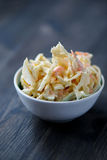 Coleslaw in a bowl on a wooden table Royalty Free Stock Images