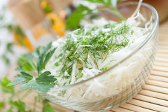 Coleslaw and dill in a transparent bowl Royalty Free Stock Images