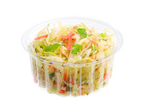 Coleslaw in a plastic packaging. Coleslaw with carrot, onion and apple in a plastic packaging isolated on white Stock Photography