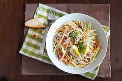 Coleslaw salad with apples, ham and hard boiled egg Royalty Free Stock Image