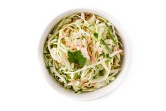 Coleslaw salad in white bowl isolated. On white background. Top view stock images