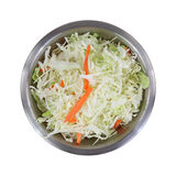 Coleslaw Stainless Steel Mixing Bowl Top View On White. A top view of a stainless steel bowl filled with  cole slaw  and fresh cut carrot sticks on a white Royalty Free Stock Photography