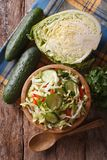 Coleslaw in a wooden bowl and ingredients top view Royalty Free Stock Photography