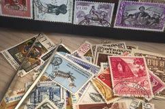 Coletando selos Fotografia de Stock
