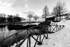 Colfiorito Umbria lake in winter, with snow all around, trees. And a small wooden building stock photo