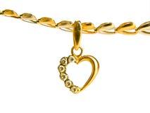 Colgante en forma de corazón del oro Foto de archivo libre de regalías