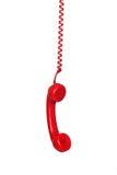 Colgante rojo del cable de teléfono Fotografía de archivo libre de regalías