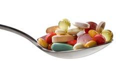 Colher com diversas medicinas Fotografia de Stock