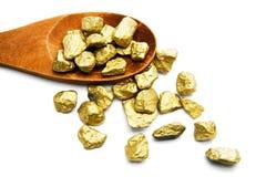 Colher de madeira com partes de ouro Fotos de Stock Royalty Free