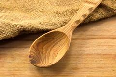 Colher de madeira na placa Imagem de Stock