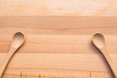 Colher de madeira no fundo de madeira Fotografia de Stock