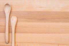 Colher de madeira no fundo de madeira Fotos de Stock