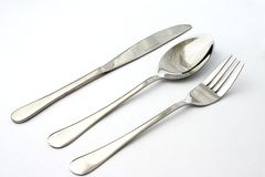 Colher e forquilha da faca no fundo branco Fotografia de Stock Royalty Free