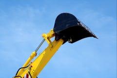 Colher levantada da máquina escavadora Imagem de Stock