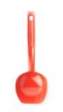 Colher plástica vermelha da cozinha isolada Fotos de Stock