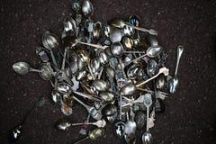 Colheres de prata com emblemas Fotos de Stock Royalty Free